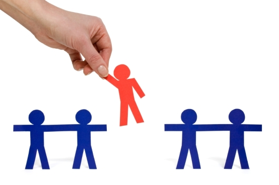 Female hand picking a chosen person from a group